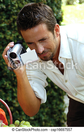 man with digital camera - csp16697557