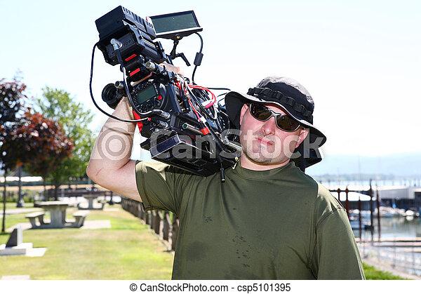 Man with digital cinema camera - csp5101395