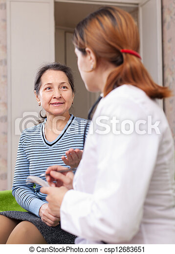 mature woman complaining to doctor - csp12683651