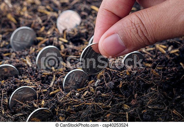 Money growth concept coins in soil - csp40253524