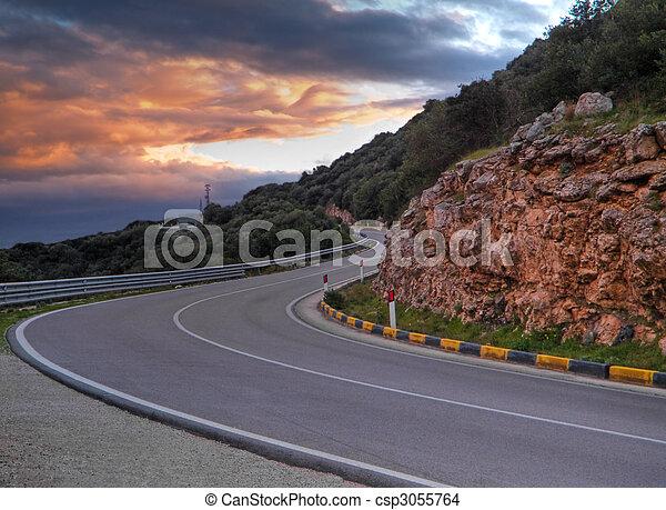 Mountain road at sunset. - csp3055764