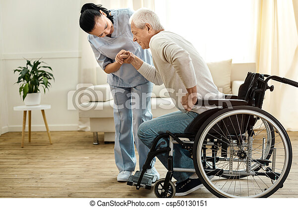 Nice aged man trying to get up - csp50130151