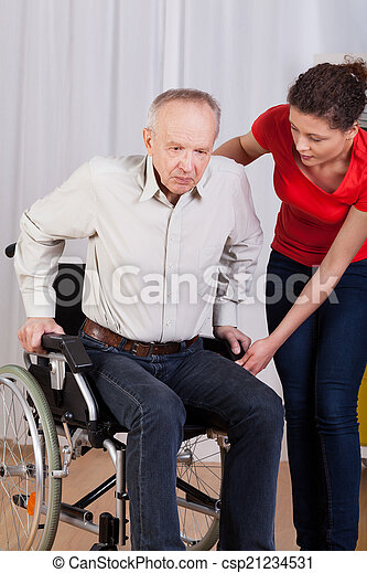 Nurse helps to get up disabled - csp21234531