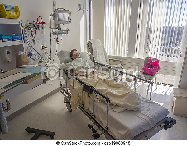 Patient asleep in hospital bed - csp19083948