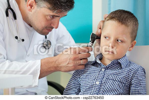 Pediatrician using otoscope - csp22763450