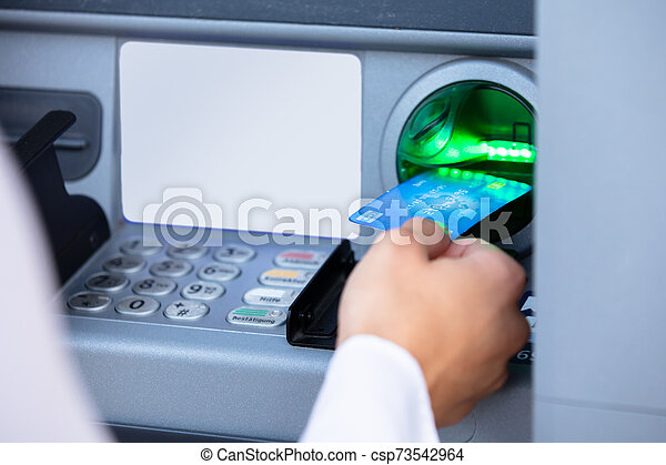 Person Using Card To Withdraw Money From ATM Machine - csp73542964