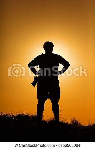 Photographer silhouette at sunset - csp6508084