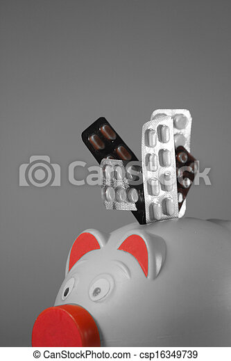Pills in Blister packs with a Piggy Bank, Concept - csp16349739