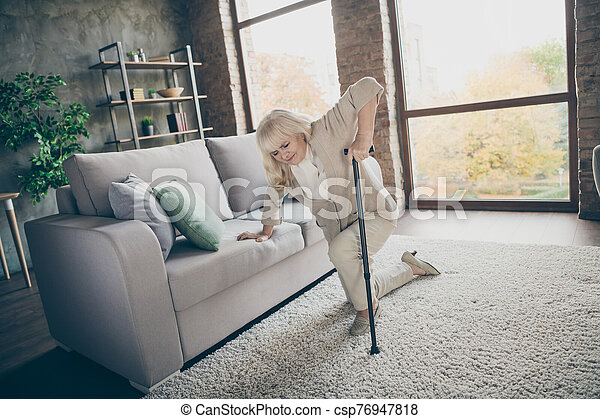 Portrait of her she nice attractive weak lonely gray-haired granny trying to get up leaning on cane feeling bad healthcare at industrial brick loft modern style interior house apartment - csp76947818