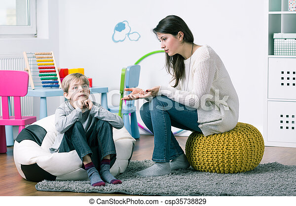 P:psychologist trying to get through to boy - csp35738829