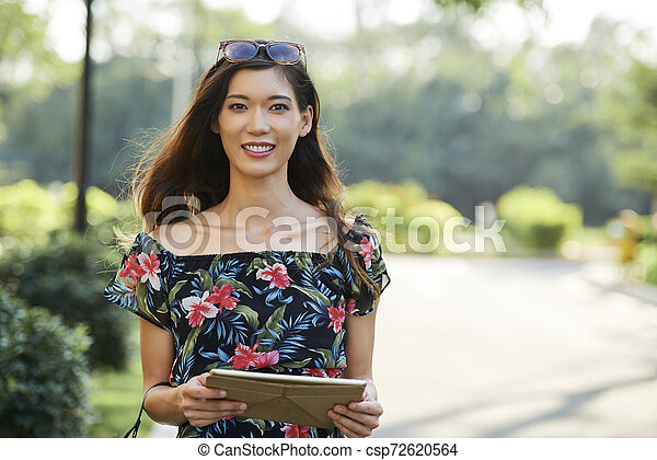 Pretty woman with digital tablet - csp72620564