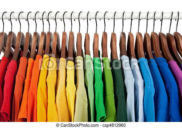 Rainbow colors, clothes on wooden hangers - csp4812960