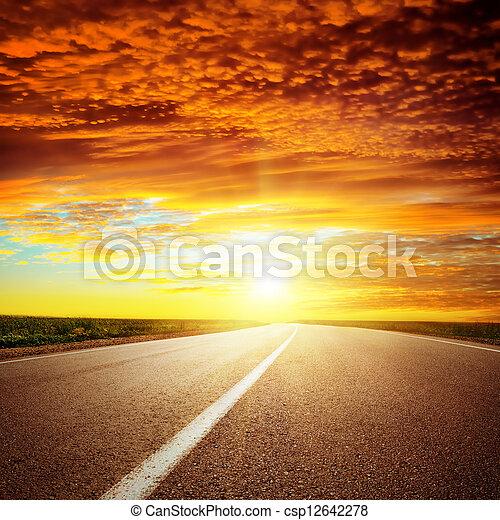 red dramatic sunset over asphalt road - csp12642278