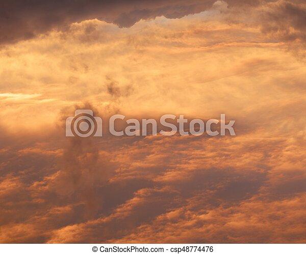 red sunrise cloudscape, top view - csp48774476