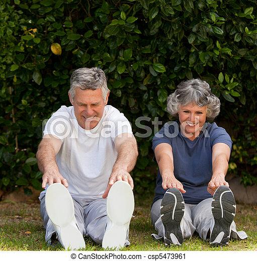 Retired couple doing their exercises - csp5473961