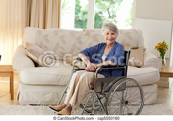 Retired woman in her wheelchair - csp5550160