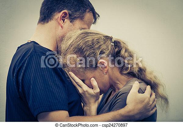 Sad woman hugging her husband - csp24270897