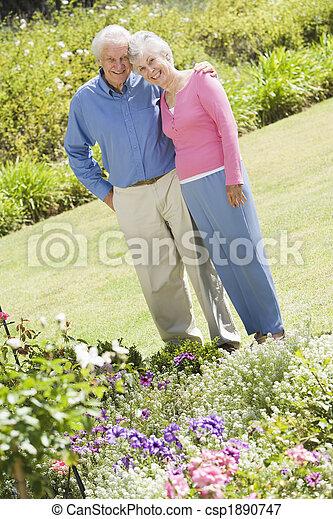 Senior couple standing in garden - csp1890747