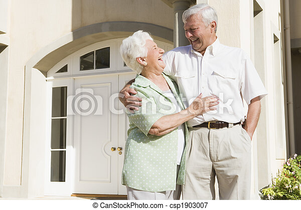 Senior couple standing outside house - csp1903007