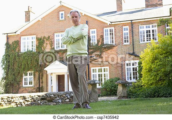 Senior Man Standing Outside House - csp7435942