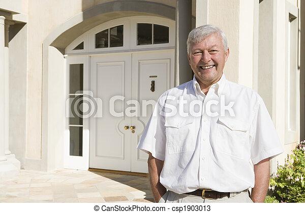 Senior man standing outside house - csp1903013
