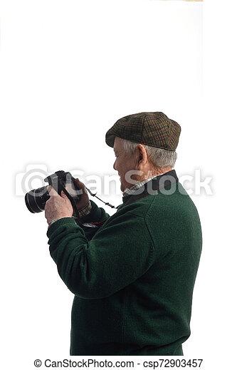 senior man with camera - csp72903457