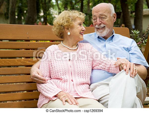 Seniors Relaxing in Park - csp1269394