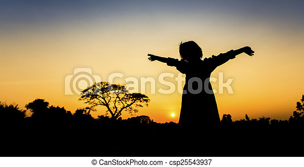 Silhouette freedom a Little girl at sunset - csp25543937