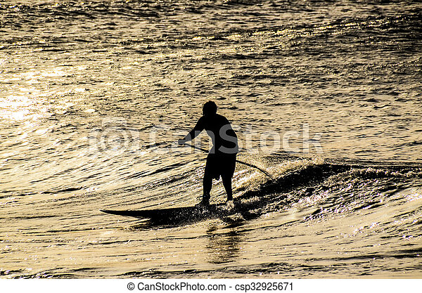 Silhouette Surfer at Sunset - csp32925671