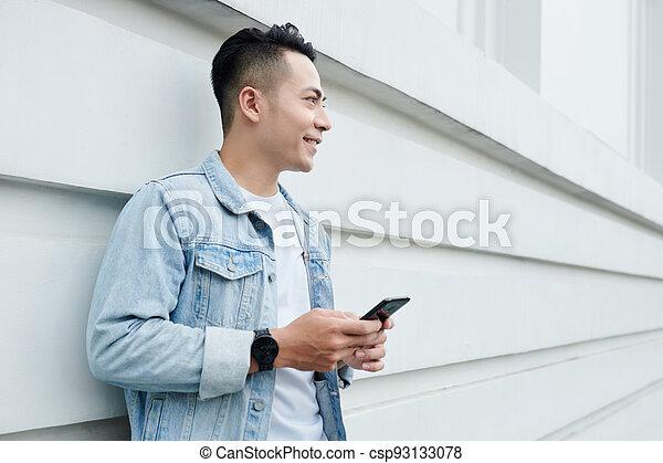 Smiling Vietnamese Man with Smartphone - csp93133078