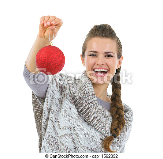 Smiling woman in sweater holding Christmas ball - csp11592332