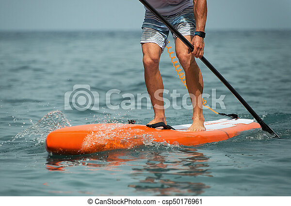 Stand up paddle board man paddleboarding - csp50176961