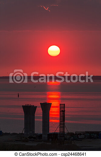 sun in red sky - csp24468641