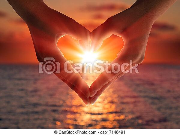 sunset in heart hands - csp17148491