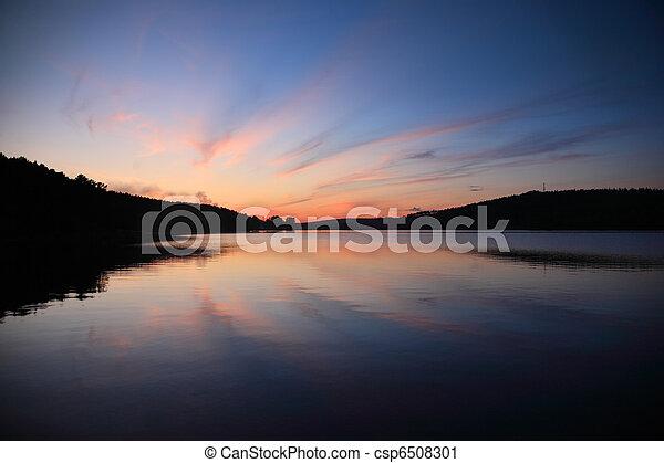 Sunset over lake - csp6508301