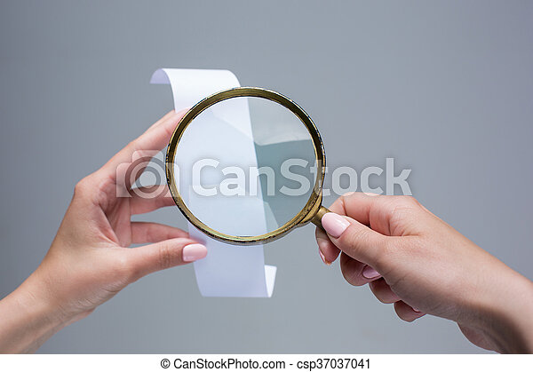 The female hands with empty transaction paper or paper check and magnifier - csp37037041