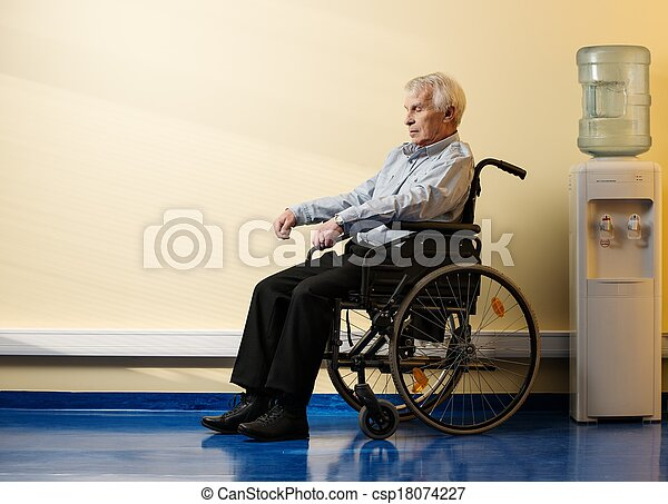 Thoughtful senior man in wheelchair in nursing home - csp18074227