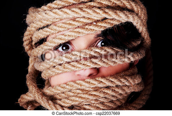 Tied up scared woman face. - csp22037669