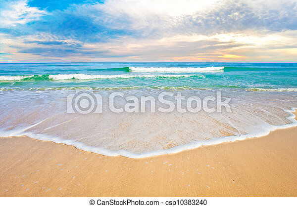 tropical ocean beach sunrise or sunset - csp10383240