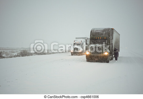 Truckers putting on chains - csp4661006
