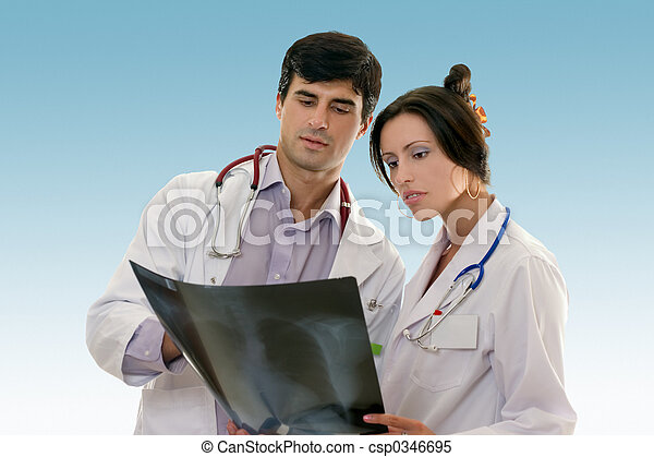Two doctors conferring over x-ray results - csp0346695