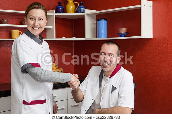 two nurses giving each other the hand - csp22829738