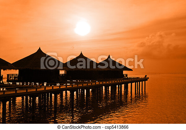 Water bungalows and sunset - csp5413866