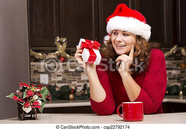 woman holding Christmas present - csp22792174