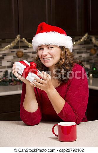 woman holding Christmas present - csp22792162