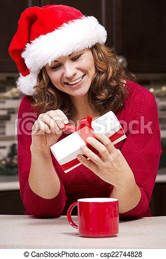 woman holding Christmas present - csp22744828