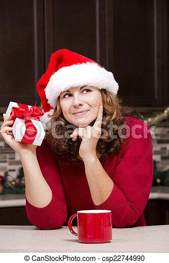 woman holding Christmas present - csp22744990
