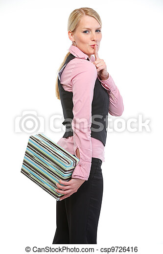 Woman holding present box behind back and showing shh gesture - csp9726416