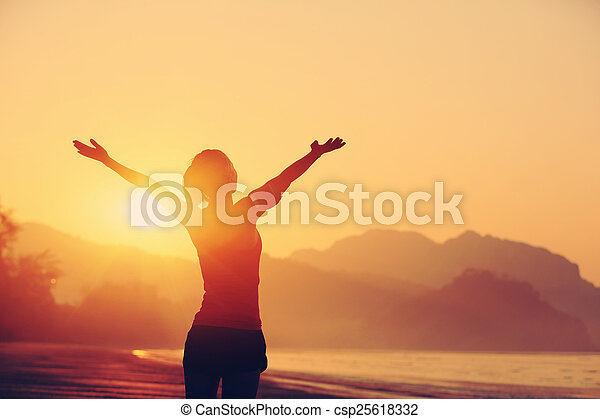 woman open arms under the sunrise - csp25618332