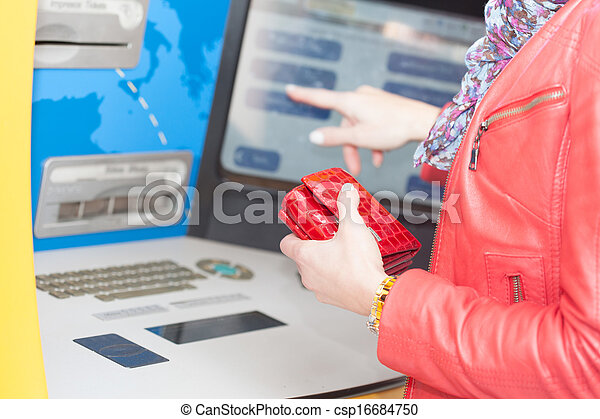 Woman selecting a transaction on a bank ATM - csp16684750